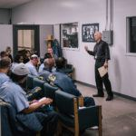 Chris speaking to inmates