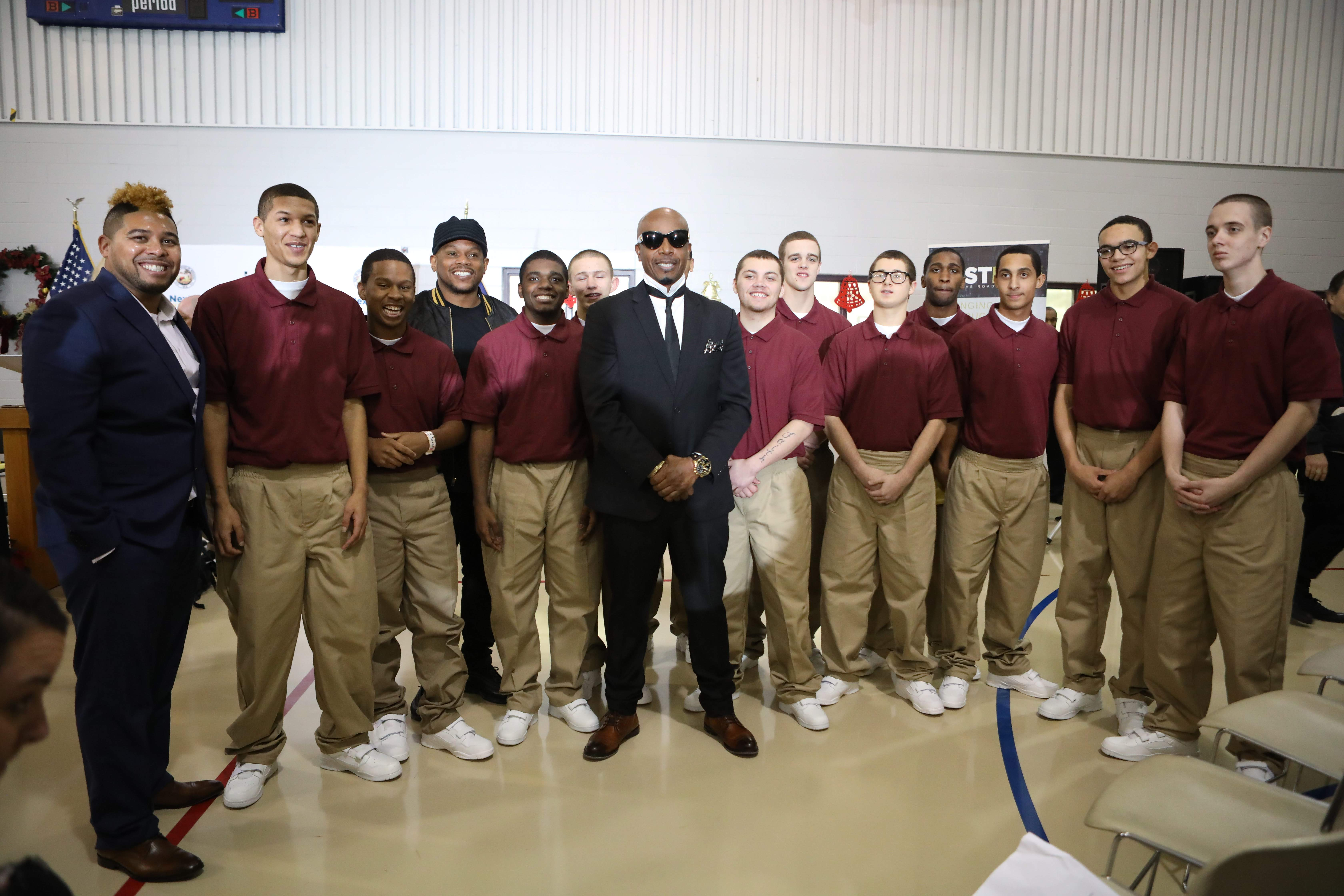 Jason Jones, Sway Calloway and MC Hammer with the new class at the Pendleton Youth Facility